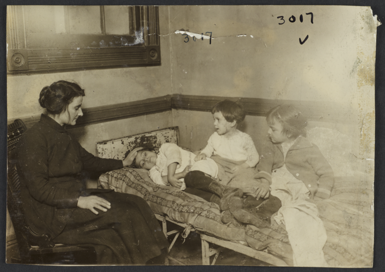 Woman with Children on Bed