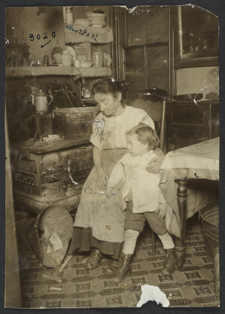 Woman and Child Near Table