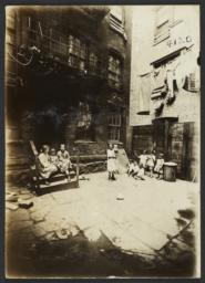 Children Between Buildings