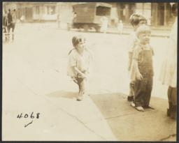 Children on Sidewalk, Horse in Background
