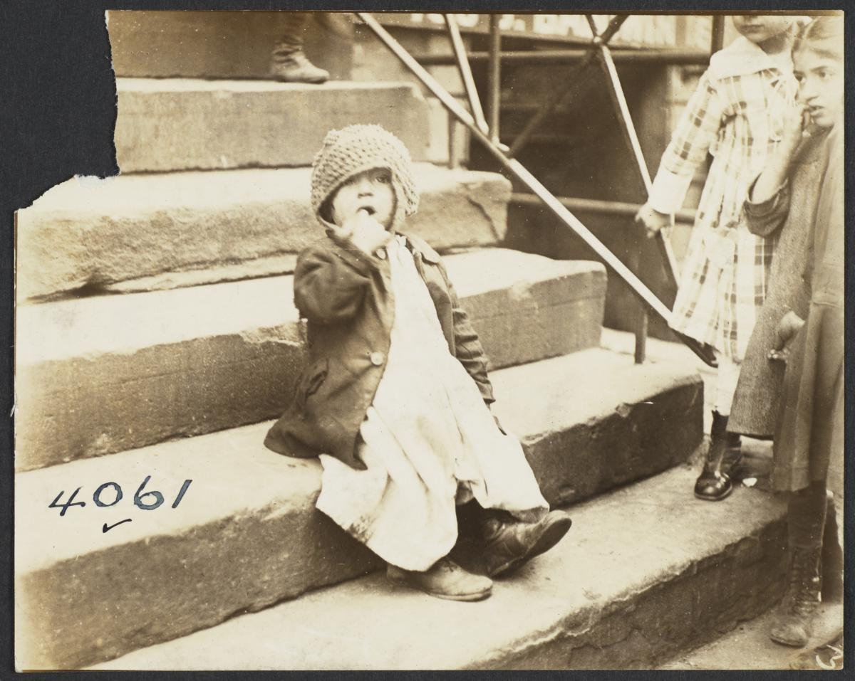 Girl in Hat on Stairs