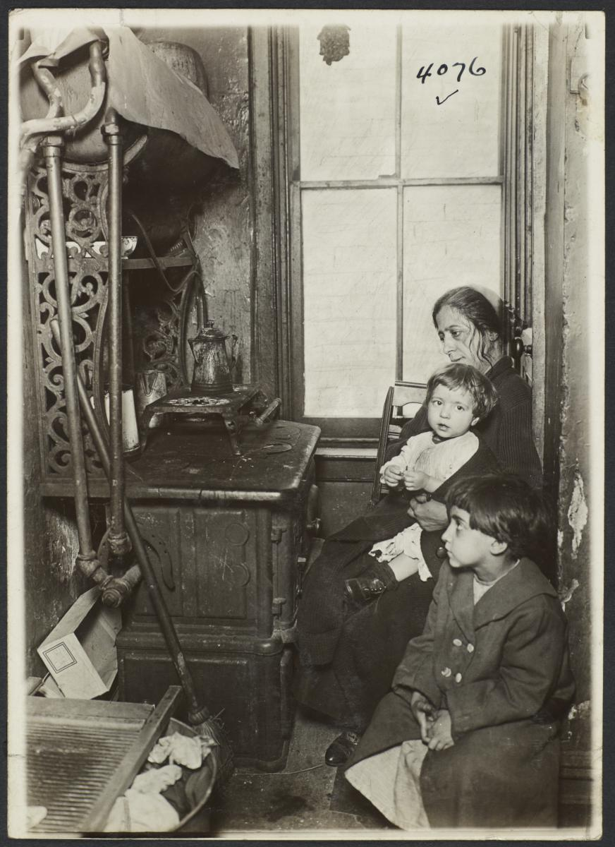 Woman and Children near Stove