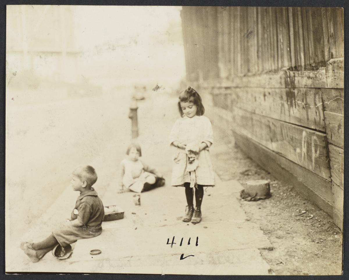 Three Children near Wooden Fence