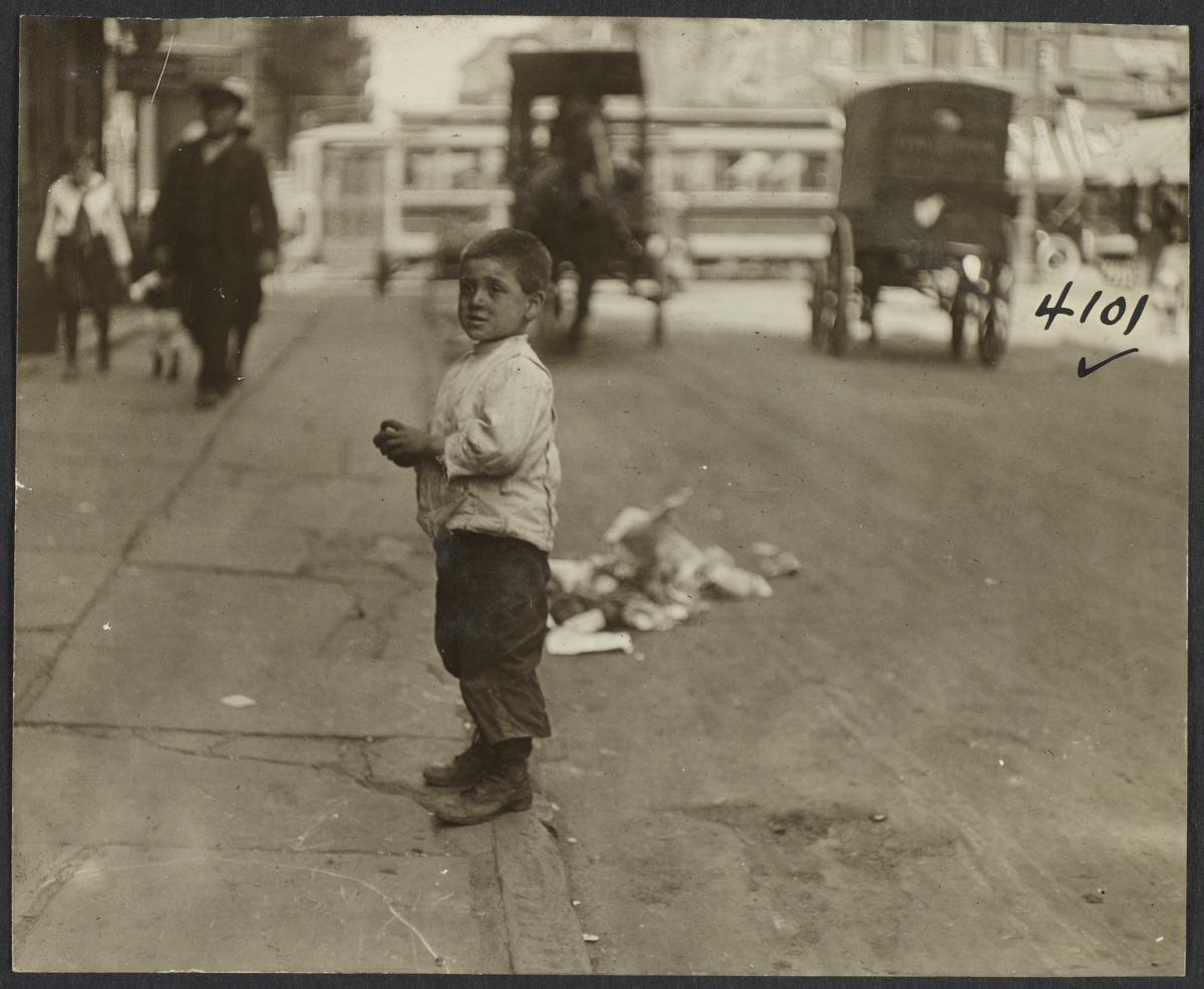 Boy on Curb near Horse Drawn Carraiges