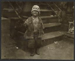 Boy in Hat near Stairs