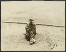 Boy Sitting on Dirt