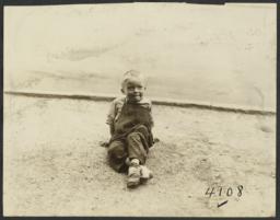 Boy Sitting on Dirt