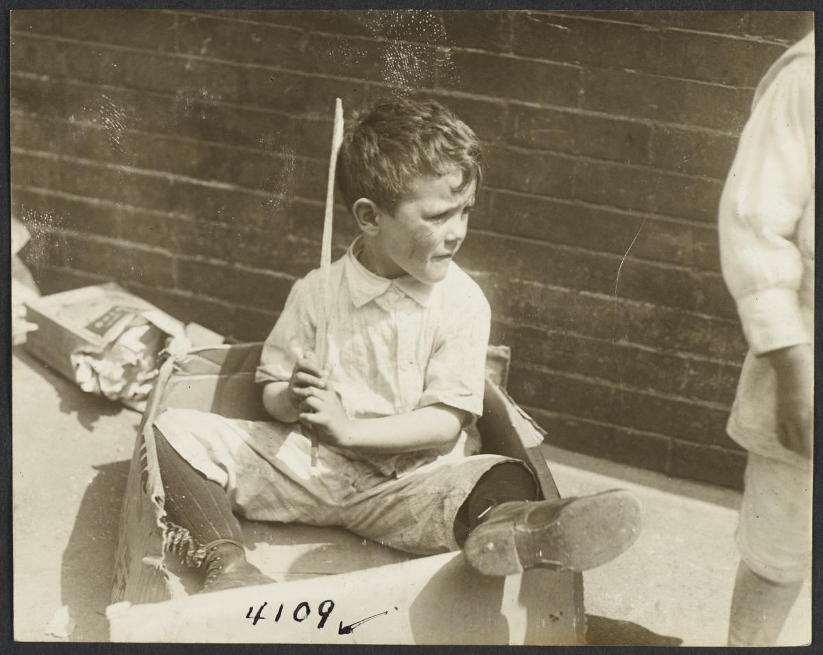 Boy Sitting in Cardboard Box