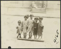 Children Standing on Frame