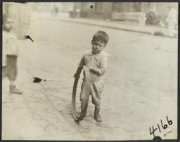 Boy with Metal Circle