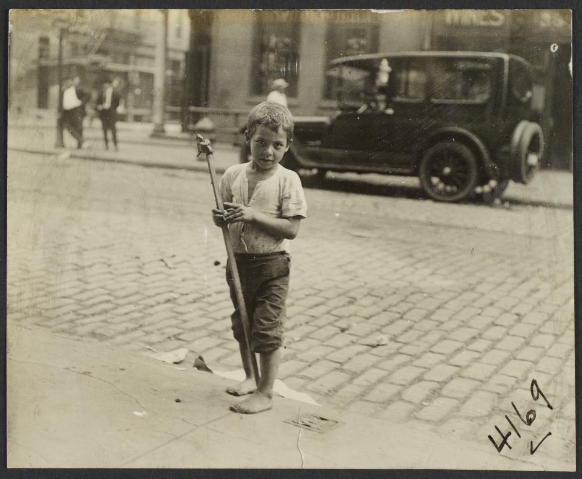 Boy with Stick on Curb