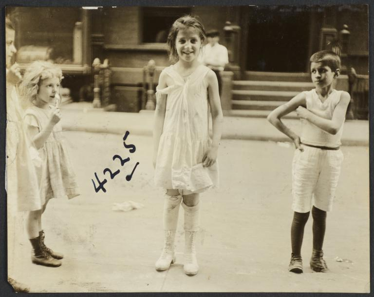 Girl with Ripped Dress and Other Children