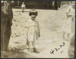 Girl near Mound of Dirt