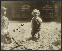 Two Children in Mound of Dirt