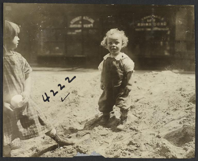 Two Children in Mound of Dirt