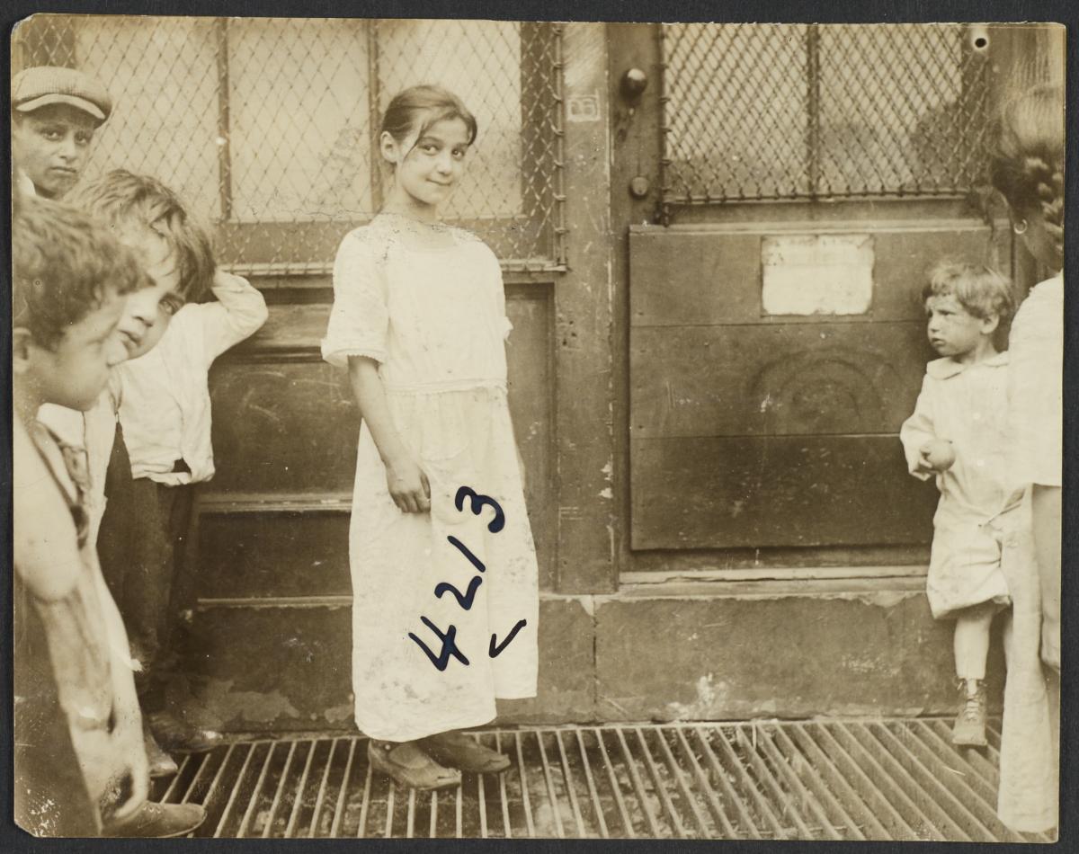 Children on Grate near Door