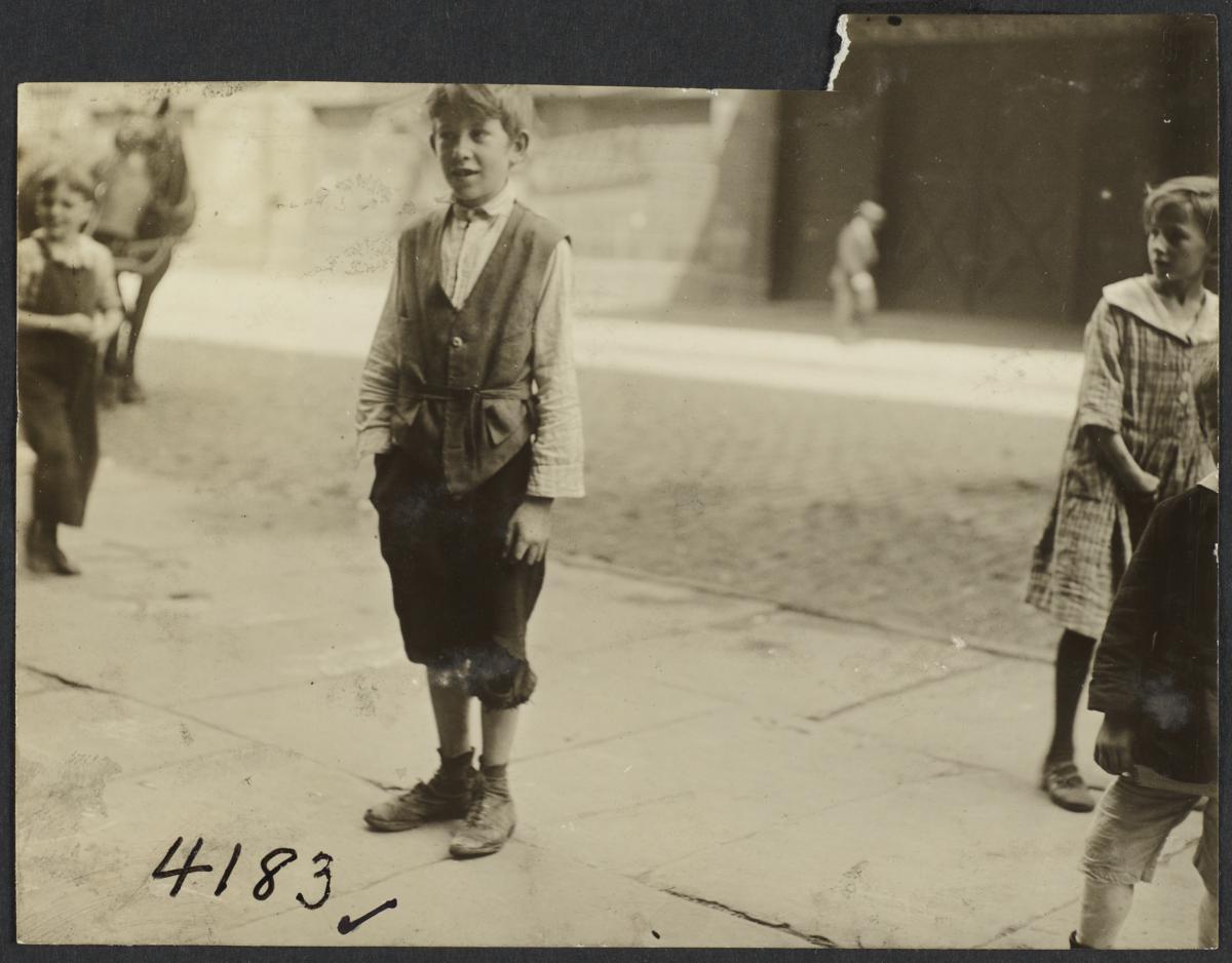 Child on Sidewalk with Hand in Pocket