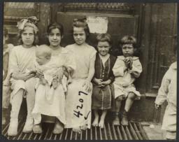 Children Sitting near Door