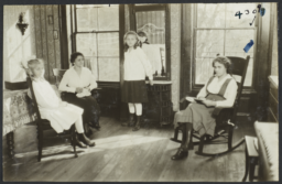 Two Women and Two Girls in Room