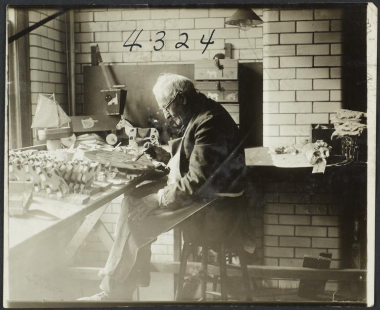 Old Men's Toy Shop Album -- Old Man Painting in Toy Shop