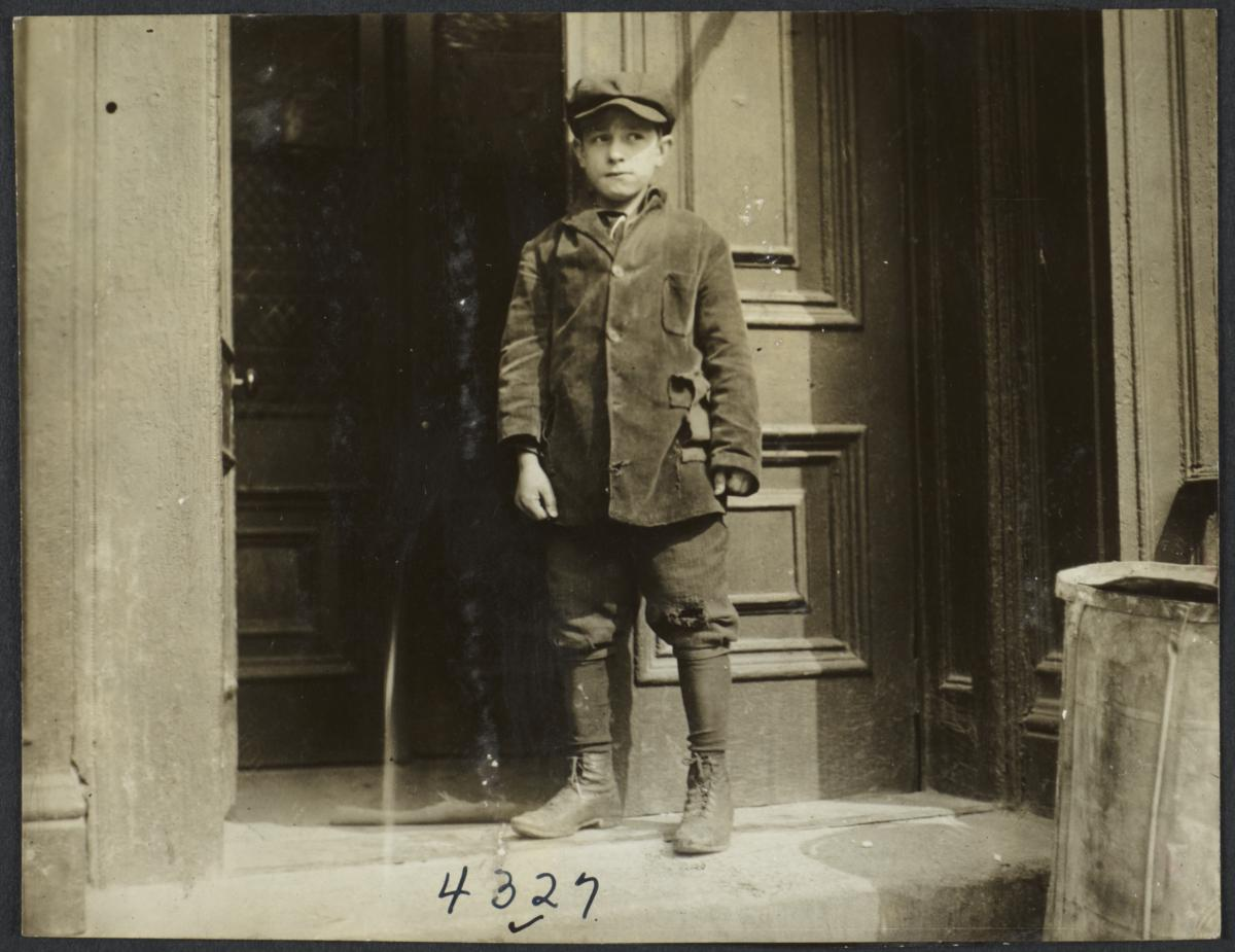 Boy Standing at Entrance to Building