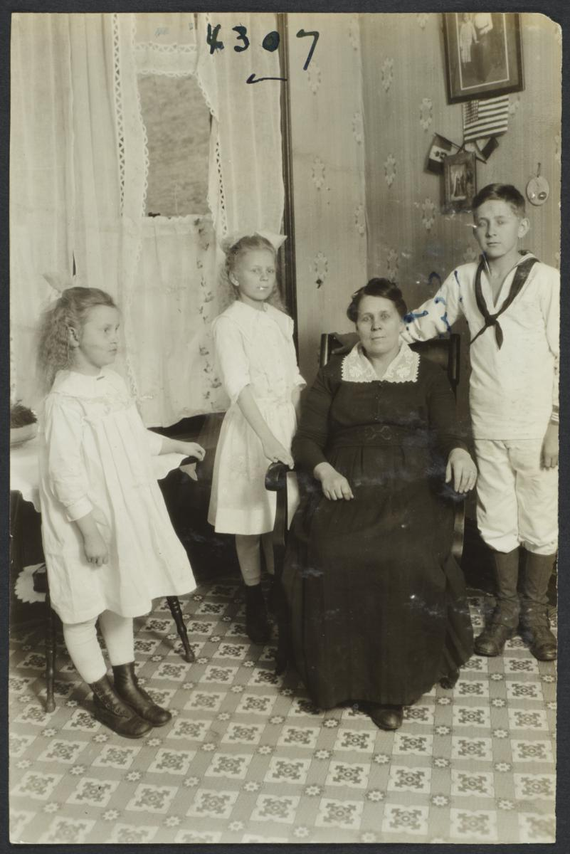 Seated Woman  with Three Standing Children