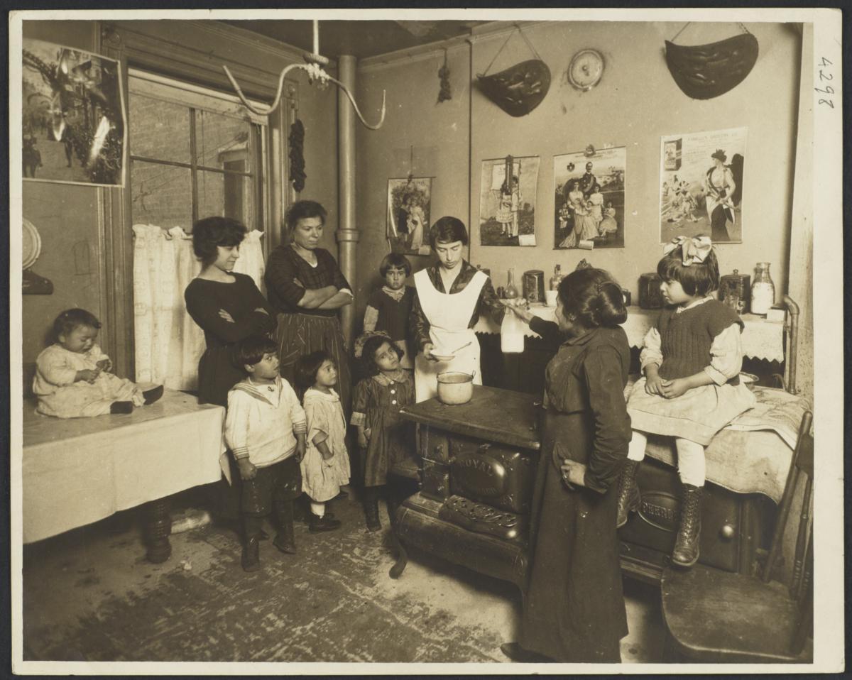 Mulberry Health Center Album -- Woman Handing Milk to Nutritionist
