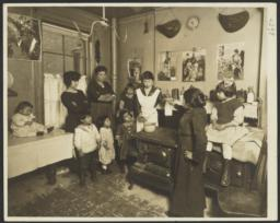 Mulberry Health Center Album -- Woman Handing Milk to Nutritionist