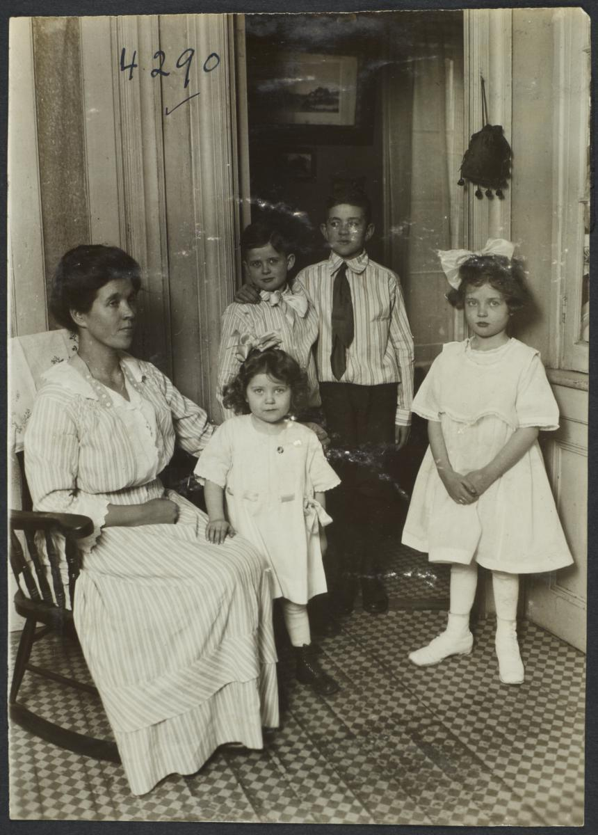 Seated Woman with Four Standing Children