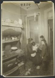 Family with Crying Baby in Kitchen
