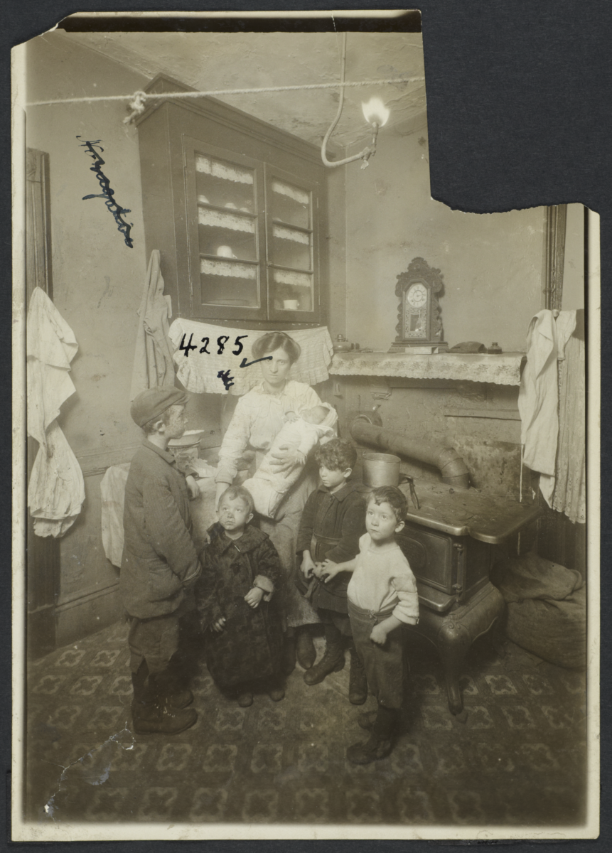 Mother with Baby and Four Boys