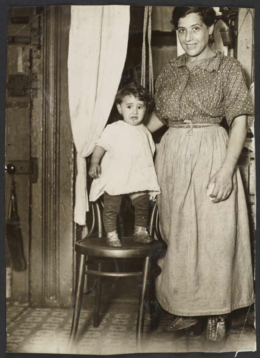 Mulberry Health Center Album -- Woman with Child on Chair