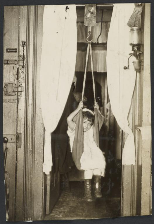 Mulberry Health Center Album -- Child in Hanging Scale