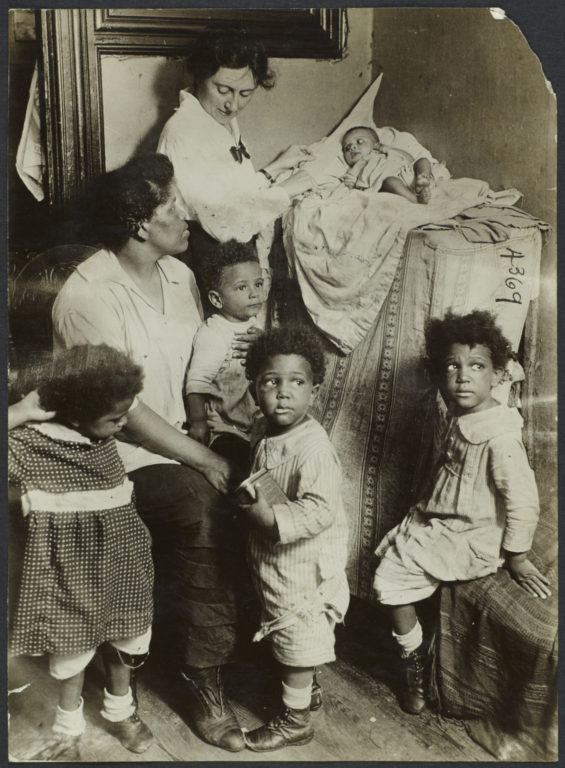 Columbus Hill Health Center Album -- Woman  with Five Children and Nurse