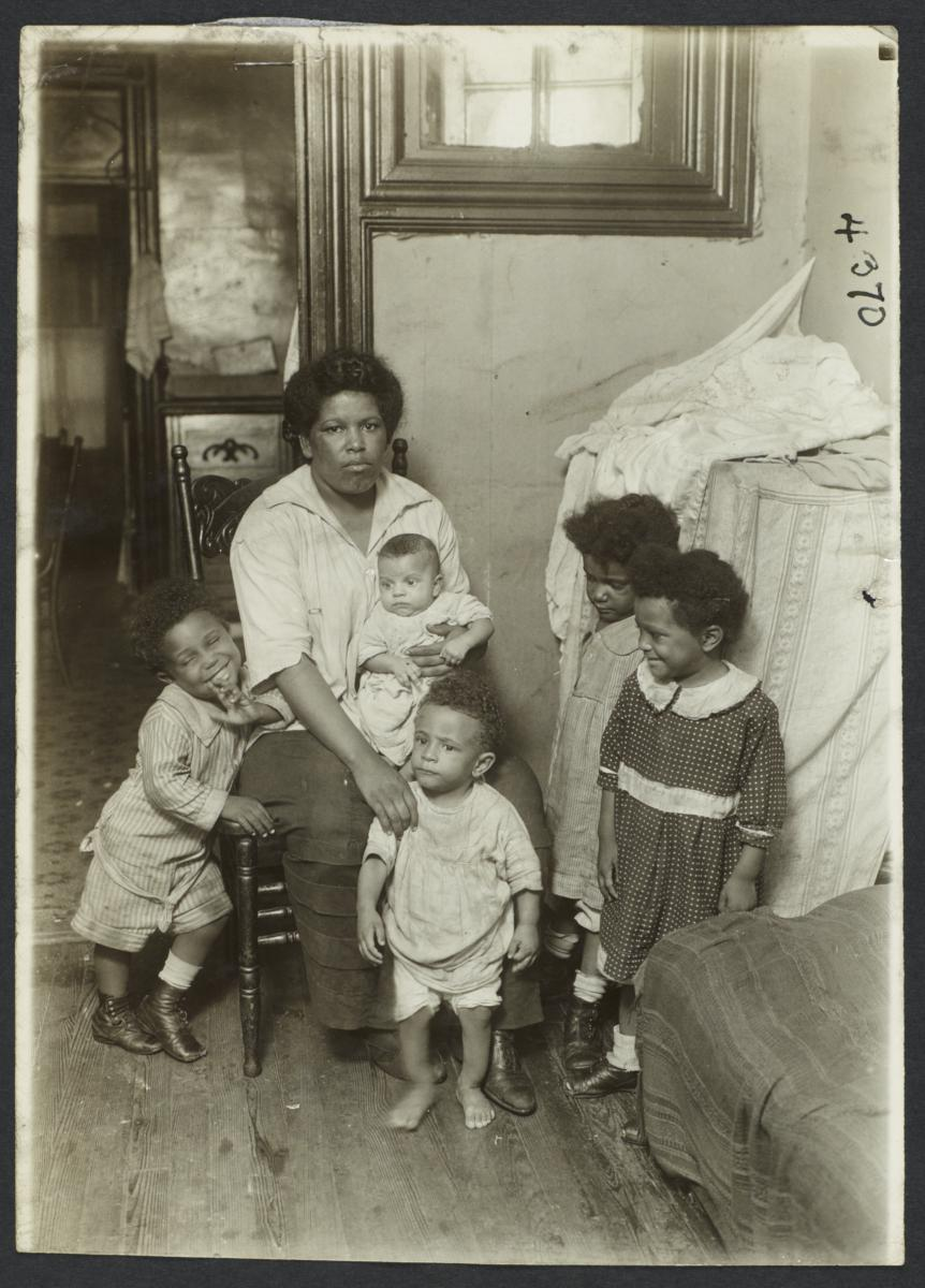 Columbus Hill Health Center Album -- Woman with Four Children and Baby