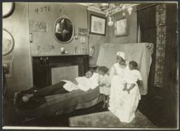 Columbus Hill Health Center Album -- Man on Sofa with Family