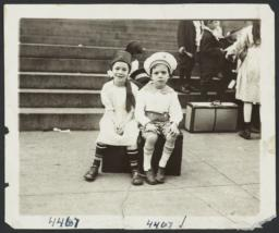 Children Sitting on Suitcase