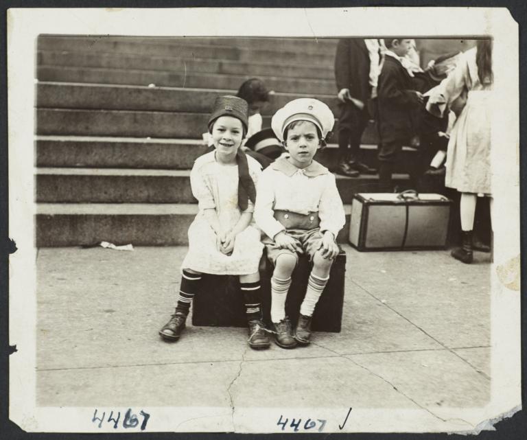 Children Sitting on Suitcase