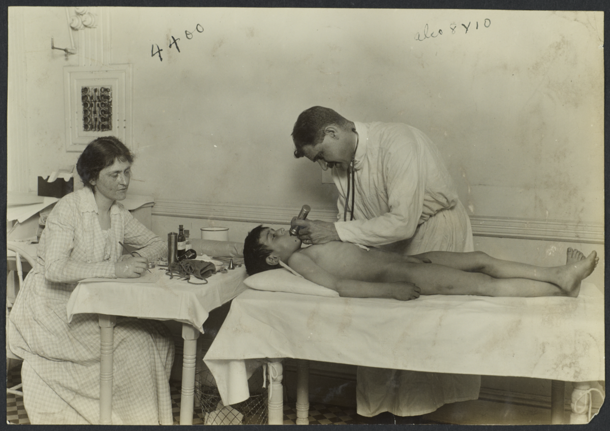 Mulberry Health Center Album -- Doctor Examining Boy