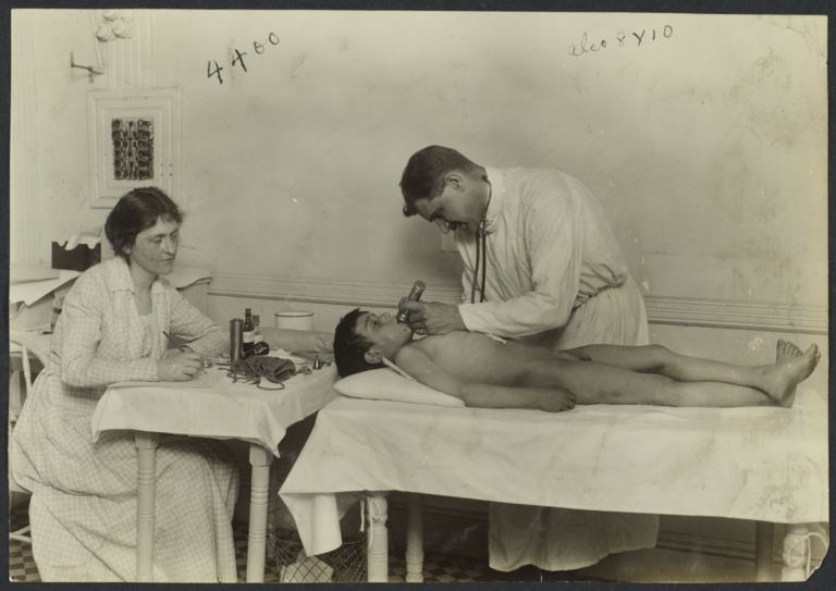 Mulberry Health Center Album -- Doctor Examining Boy -5310