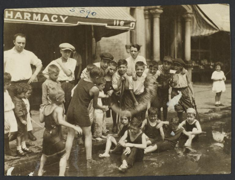 Children Playing in Water on Street