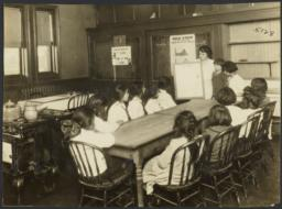 Mulberry Health Center Album -- Woman Teaching Class of Children