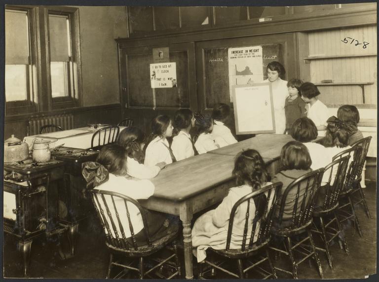 Mulberry Health Center Album -- Woman Teaching Class of Children