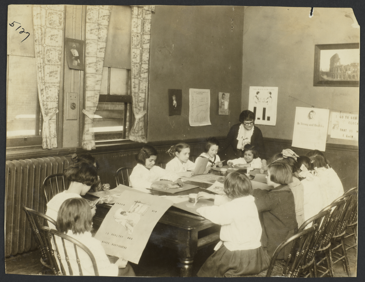 Mulberry Health Center Album -- Girls Making Posters in Class