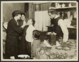 Mulberry Health Center Album -- Nurse Checking Boy's Throat