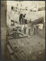 Clotheslines Over Rooster and Child