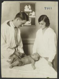 Mulberry Health Center Album -- Doctor with Woman and Baby