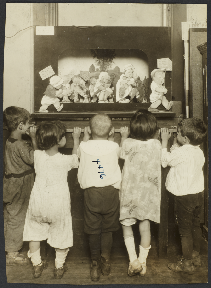 Mulberry Health Center Album -- Children Looking at Poster