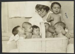 Mulberry Health Center Album -- Babies in Basket