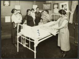 Mulberry Health Center Album -- Nurse with Mothers and Children